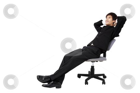Portrait of a relaxed young businessman sitting on the chair and isolated on white stock photo, Portrait of a relaxed young businessman sitting on the chair and isolated on white by tomwang