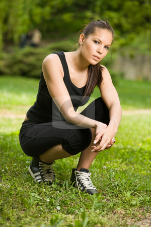 Beautiful slim brunette resting while workout. stock photo, Beautiful fit slender brunette resting while workout outdoors in nature. by exvivo