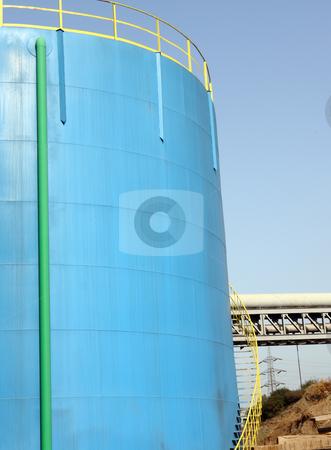 Petrol blue tank stock photo, A big petrol blue tank to deposit gasoline by Roberto Giobbi