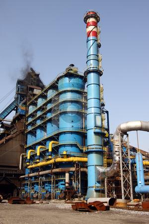 Blue Rafinery and chimney stock photo, Blue rafinery and chimney industrial and chemical site by Roberto Giobbi