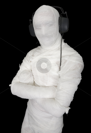 Man in bandage with ear-phones stock photo, Man in bandage with ear-phones on black by Alexey Romanov