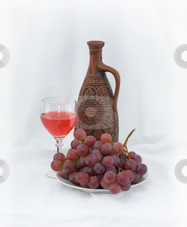 Bright still life with wine stock photo, Bright still life with grapes and wine on white by Alexey Romanov