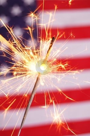 Sparkler and usa flag stock photo, sparkler and usa flag showing 4th of july by Gunnar Pippel