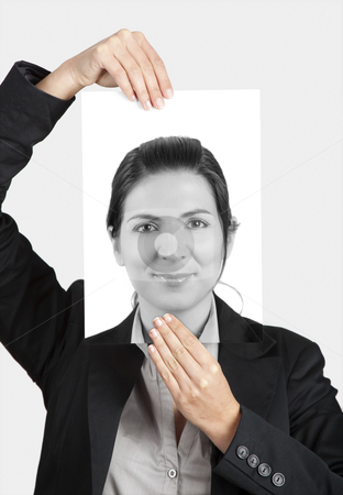 Holding a self portrait stock photo, Woman holding a self portrait in front of her face by ikostudio