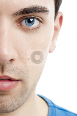 Man face stock photo, Close-up portrait of handsome young man with blue eyes by ikostudio