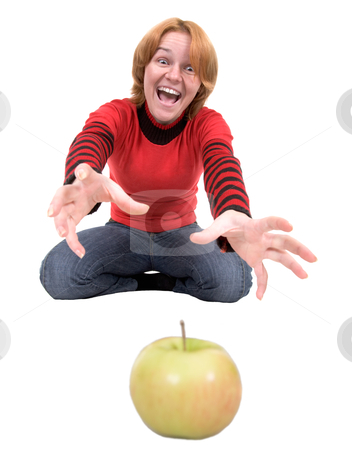 Woman stretch a hand to apple stock photo, The woman stretch a hand to a green apple by Alexey Romanov