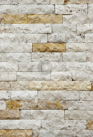 Wall stones stock photo, White and yellow wall stones on the wall by OZMedia