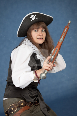 Frightened pirate girl - with pistol stock photo, Frightened pirate girl - with pistol on a blue background by Alexey Romanov