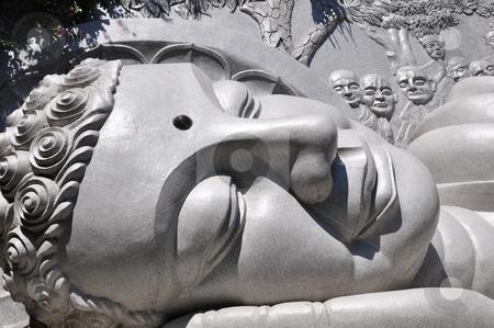 Buddha stock photo, Closeup view of a historic lying buddha statue by John Young