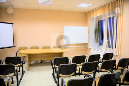 Interior of a conference hall in pink tones stock photo, Interior of a small conference hall in pink tones by Alexey Romanov
