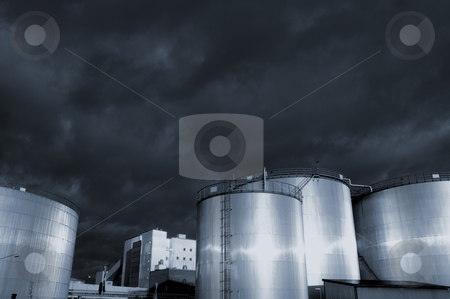 Fuel and oil storage tanks, towers stock photo, fuel and oil-storage tanks, towers, sunlight gleaming in metal, blue toning concept by lagereek