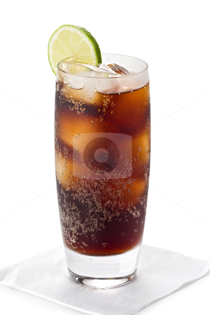 Glass of Cola stock photo, Glass of iced cold cola with a slice of lime on a paper napkin. by Glenn Price
