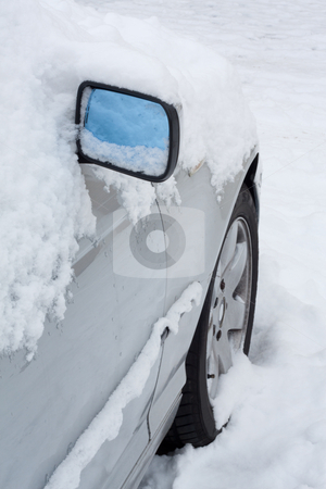 Car covered in snow stock photo, Closeup of a car covered in snow. by Brigida Soriano