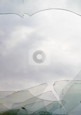 View through broken window at cloudy sky stock photo, A view through a broken window at the cloudy sky by Alexey Romanov