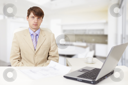 Young serious businessman on a workplace stock photo, The young serious businessman on a workplace with the laptop by Alexey Romanov
