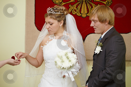 Moment of wearing of wedding rings stock photo, The moment of wearing of wedding rings at wedding ceremony by Alexey Romanov