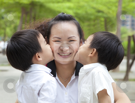 Happy mothers day. two kids kissing mother stock photo, Happy mothers day. two kids kissing mother by tomwang