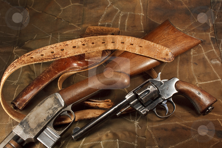 Vintage Revolver and Rifle stock photo, 1901 revolver with an early 1900's rifle and leather by Opticalreflex