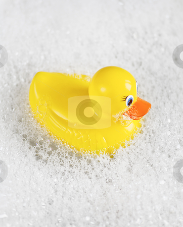 Rubber Ducky bathtime stock photo, Bathtime fun with a yellow rubber ducky in a bathtub full of water and bubbles. by thisboy