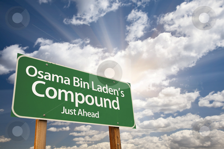 Osama Bin Laden's Compound Green Road Sign stock photo, Osama Bin Laden's Compound Green Road Sign on Dramatic Blue Sky with Clouds. by Andy Dean