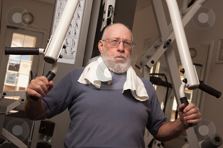 Elderly Adult Man Working Out in the Gym. stock photo, Active Senior Adult Man Working Out in the Gym. by Andy Dean