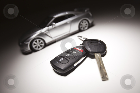 Car Key and Sports Car stock photo, Car Key, Remote and Sports Car Under Spot Light. by Andy Dean