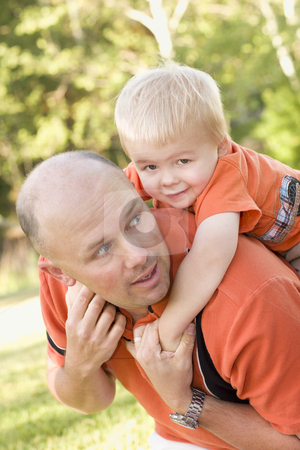 Father and Son Piggyback in the Park stock photo, Father and Son Piggyback Ride in the Park.  by Andy Dean