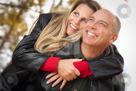 Attractive Couple in Park with Leather Jackets stock photo, Happy, Attractive Couple in Park with Leather Jackets. by Andy Dean