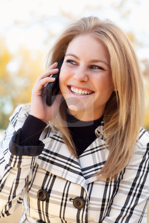 Pretty Young Blond Woman on Phone Outside stock photo, Pretty Young Blond Woman on Her Cell Phone Outside on Fall Day. by Andy Dean