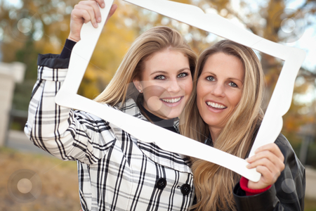 Pretty Mother and Daughter Portrait in Park with Frame stock photo, Pretty Mother and Daughter Portrait with Picture Frame in the Park on a Fall Day. by Andy Dean