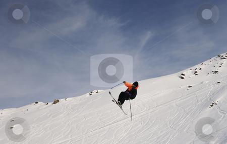 Extreme freestyle ski jump stock photo, extreme freestyle ski jump with young man at mountain in snow park at winter season by Benis Arapovic