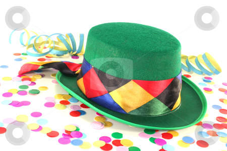 Carnival stock photo, Carnival hat with colorful confetti and streamers on white background by Marén Wischnewski
