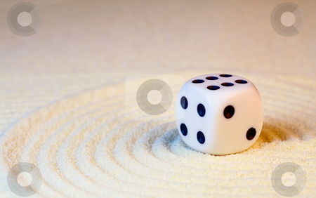 White dice with black dots stock photo, White dice with black dots in Japanese rock-garden by Alexey Romanov