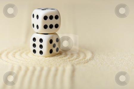 Two white dice with black dots on sand stock photo, Two white dice with black dots in Japanese rock-garden by Alexey Romanov