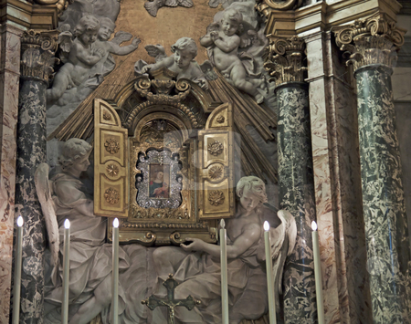 Tabernacle stock photo, Tabernacle in a church with statues of angels by Fabio Alcini