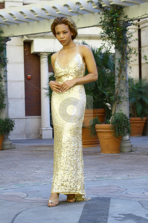 WOMAN IN GOLD EVENING GOWN stock photo, Beautiful woman in gold sequined evening gown by DJIMAGESINC