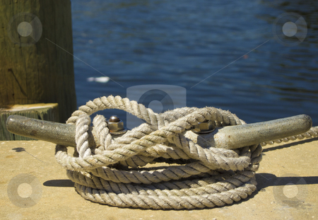 Boat cleat on a dock stock photo, Photo image of a Boat cleat on a dock by P.J. Lalli