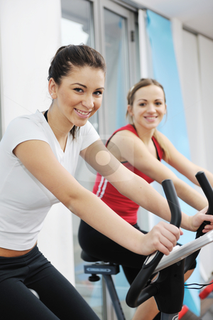 Woman workout  in fitness club on running track  stock photo, young woman exercise fitness and workout while run on track in sport club by Benis Arapovic