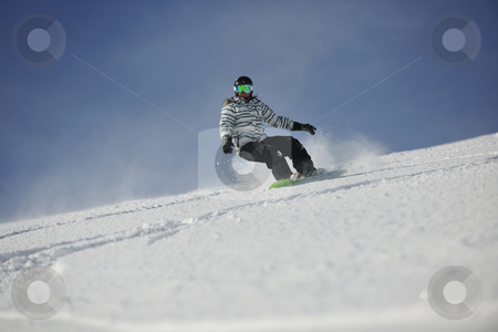 Snowboard woman stock photo, snowboard woman racing downhill slope and freeride on powder snow at winter season and sunny day by Benis Arapovic