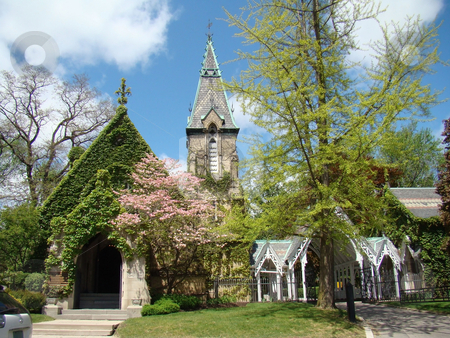 Vinage Church stock photo,     Vintage church surrounded by trees and flowers                            by CHERYL LAFOND