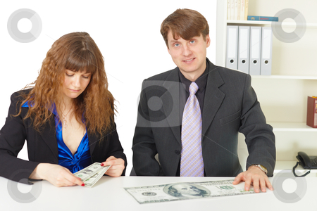 Man and woman have different wages stock photo, Man and woman have different wages in office by Alexey Romanov
