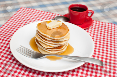 Pancakes With Butter and Maple Syrup stock photo, Pancakes With Butter and Warm Maple Syrup On The Table by JAMDesign