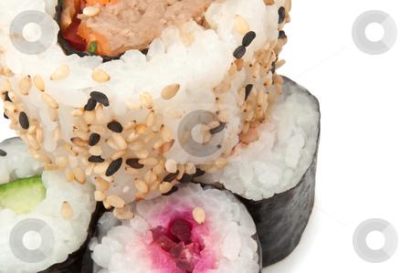Fresh Maki stock photo, Close up on several fresh Maki Rolls arranged over white by Samantha Craddock