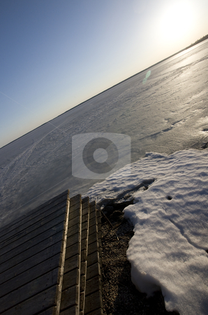 Winter Dock at Lake stock photo, Winter Dock at Lake Manitoba Canada Frozen by Mark Duffy