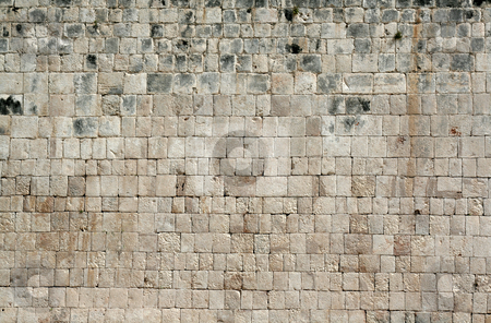 Ancient Wall stock photo, A closeup of a stone wall at Chichen Itza.  by Chris Hill