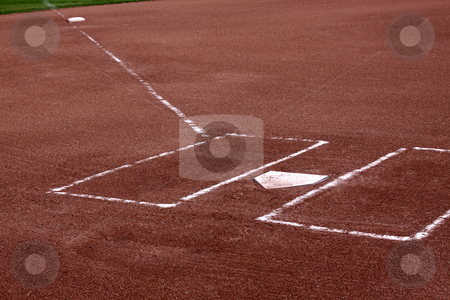 Clay Batters Boxes stock photo, A close-up of the batters boxes and home plate on a vacant baseball diamond. by Chris Hill