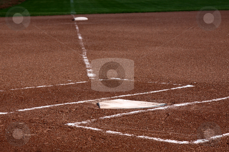 Close-up of Home Plate stock photo, The view down the left field line with home plate and the batters boxes in focus. by Chris Hill