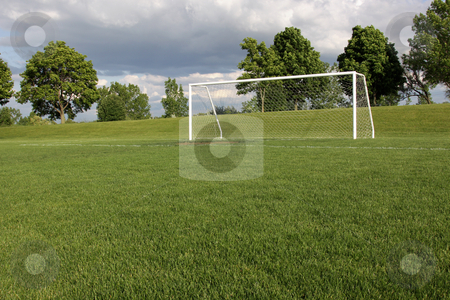 Soccer Goal Vacancy stock photo, A view of a net on a vacant soccer pitch.  by Chris Hill