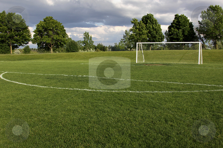 Unoccupied Soccer Goal stock photo, A view of a net on a vacant soccer pitch.  by Chris Hill