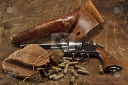 1901 Revolver with Holster and Ammunition stock photo, 1901 American military revolver with US Cavalry leather holster and a leather pouch of vintage .38 caliber ammunition by Opticalreflex